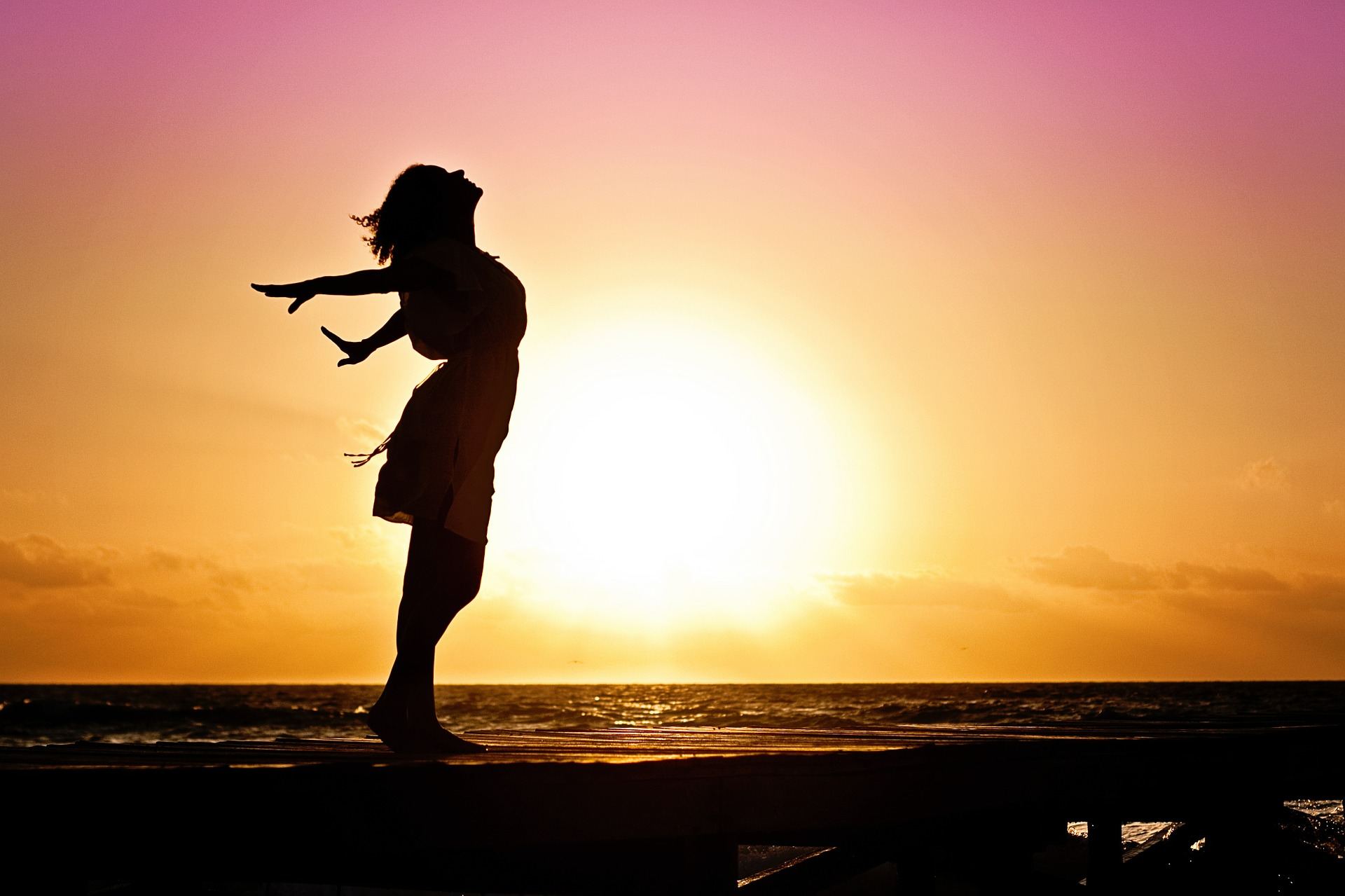 Woman in silhouette against the sunset